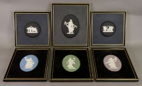 A set of four Wedgwood jasper dip oval classical plaques, each 12 x 8.