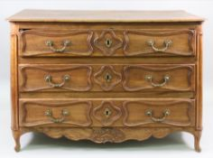 A Louis XV provincial oak commode, of panelled construction,