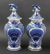 A pair of Dutch Delft blue and white hexagonal baluster vases and covers, late 18th century,