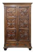 A French walnut provincial armoire, late 18th/early 19th century, of panelled construction,