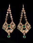 A pair of yellow precious metal, emerald and diamond set pendant earrings, Indian,