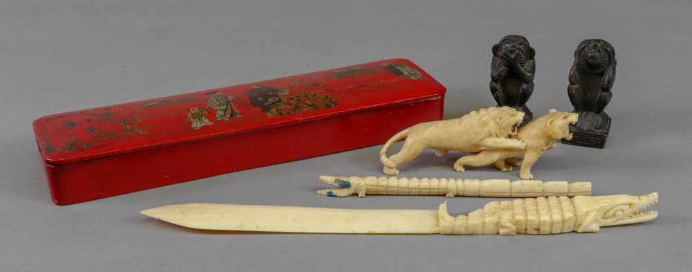 Lot 236 - A chinoiserie decorated red lacquered pen box, early 20th century, rectangular with hinged cover,