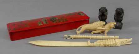 A chinoiserie decorated red lacquered pen box, early 20th century, rectangular with hinged cover,