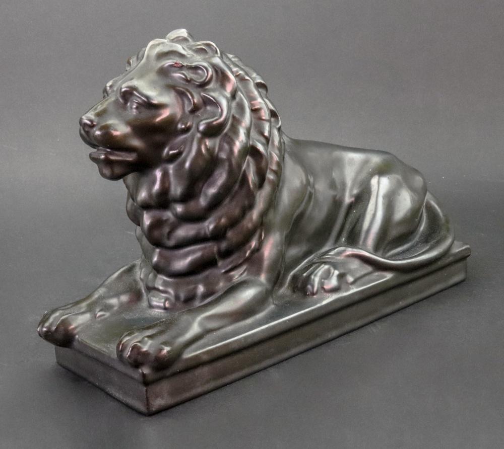 Lot 14 - A Teichert-Werke Meissen figure of a lion, with bronze glaze, 26.5cm x 17.5cm.