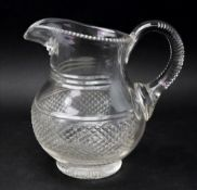 A Regency style glass baluster shape water jug, the wide diamond cut band with split cutting above,