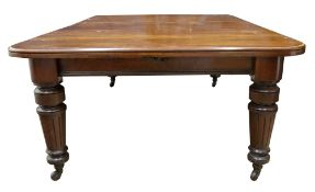 A late Victorian mahogany extending dining table,