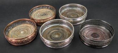 Two pairs of Regency style electroplate coasters, one with slat and star pierced sides,