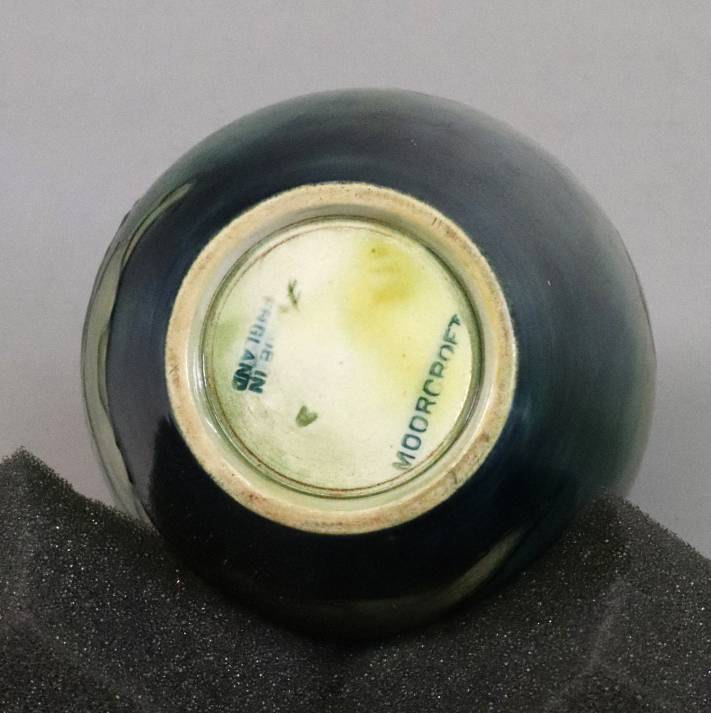 Lot 75 - A Moorcroft Dahlia pattern ovoid vase, decoarated against a green/blue ground, 13.5cm high.