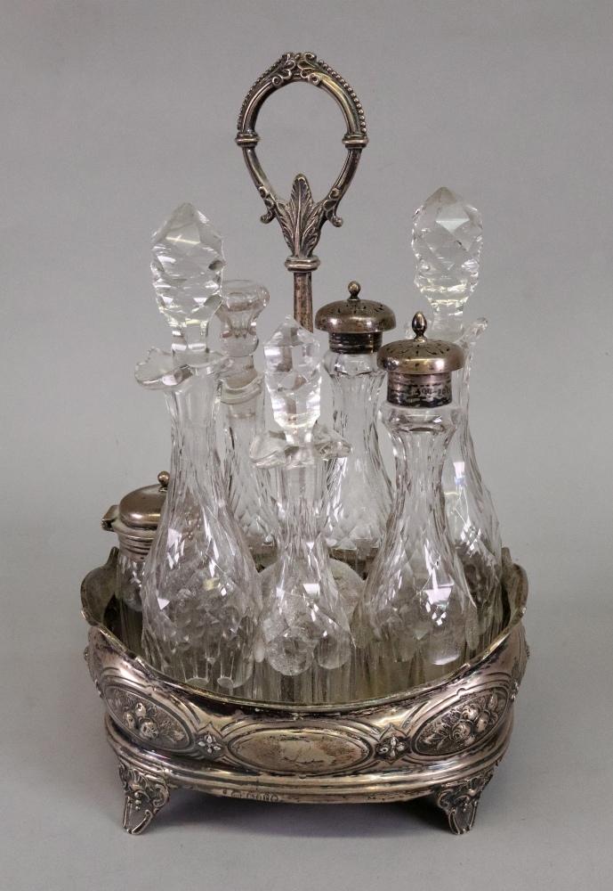 Lot 259 - A Victorian oval silver cruet stand, Charles Boyton, London 1872,