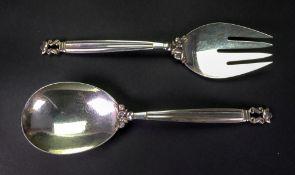 Georg Jensen; a pair of Danish acorn pattern serving spoon and fork, detailed sterling Denmark,