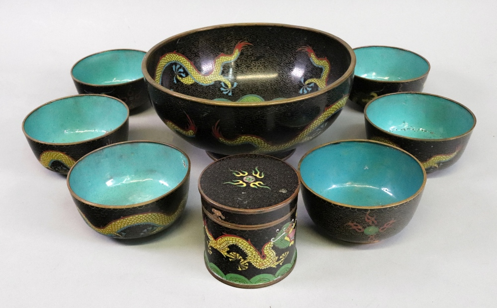 Lot 244 - A Chinese cloisonne bowl, decorated with dragons and centred by a floral roundel, 22cm diameter,