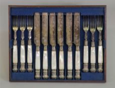 A set of six pairs of Victorian electroplate fruit knives and forks,
