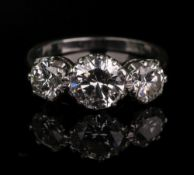 An 18ct white gold and diamond three-stone ring, total diamond weight approximately 2.