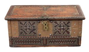 A Zanzibar hardwood chest, of panelled construction, decorated with typical brass studwork,