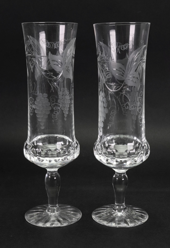 Lot 26 - A set of 23 vine etched and split cut glass champagne flutes.