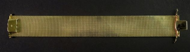 A 14ct gold fancy-link bracelet designed as a wide textured strap,