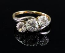An 18ct gold three-stone diamond cross-over ring,