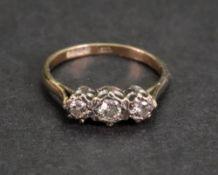 A 9ct gold and three-stone diamond ring, the circular-cut diamonds,
