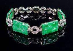 A jadeite and diamond-set bracelet, composed of four carved rectangular jadeite plaques,