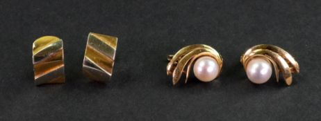 A pair of cultured pearl and yellow precious metal earclips, of scrolling design,