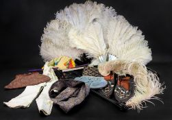 An ostrich feather fan with mother of pearl sticks and guard, another in faux tortoiseshell,