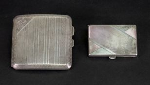 An engine turned silver cigarette case, Chester 1922, curved to fit the pocket,