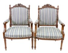 A pair of reproduction Louis XVI style mahogany fauteuil, the moulded frames with upholstered backs,