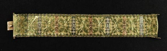 A 14ct tri-gold fancy-link bracelet designed as a wide textured strap,