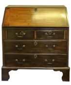 A mahogany bureau, of small proportions, reconstructed from a larger George III bureau,