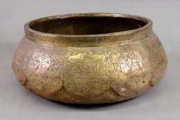 An Indian brass compressed circular bowl, late 19th/early 20th century,