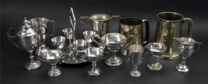 A collection of electroplate tennis and golf trophies,