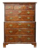 A George I walnut cross and feather banded tallboy chest, reduced in height,