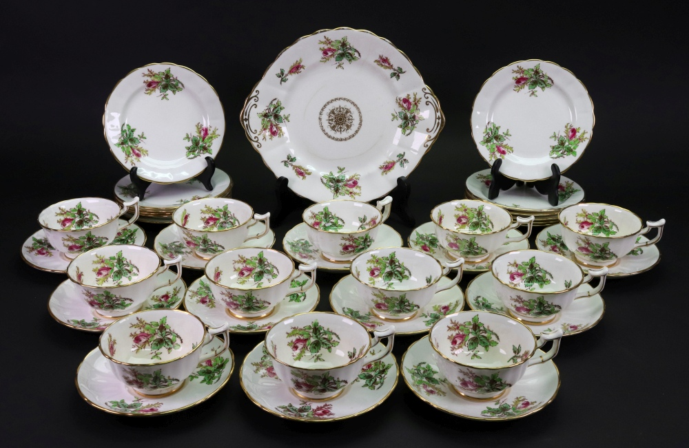 Lot 69 - A New Chelsea tea service, retailed by Thomas Goode & Co, painted with roses, 12 each tea cups,