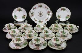 A New Chelsea tea service, retailed by Thomas Goode & Co, painted with roses, 12 each tea cups,