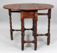 A late 17th century oak gateleg table, of good colour, with hinged oval top above an end drawer,