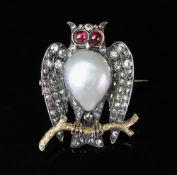 A late 19th/early 20th century diamond, pearl and ruby owl brooch, realistically formed,