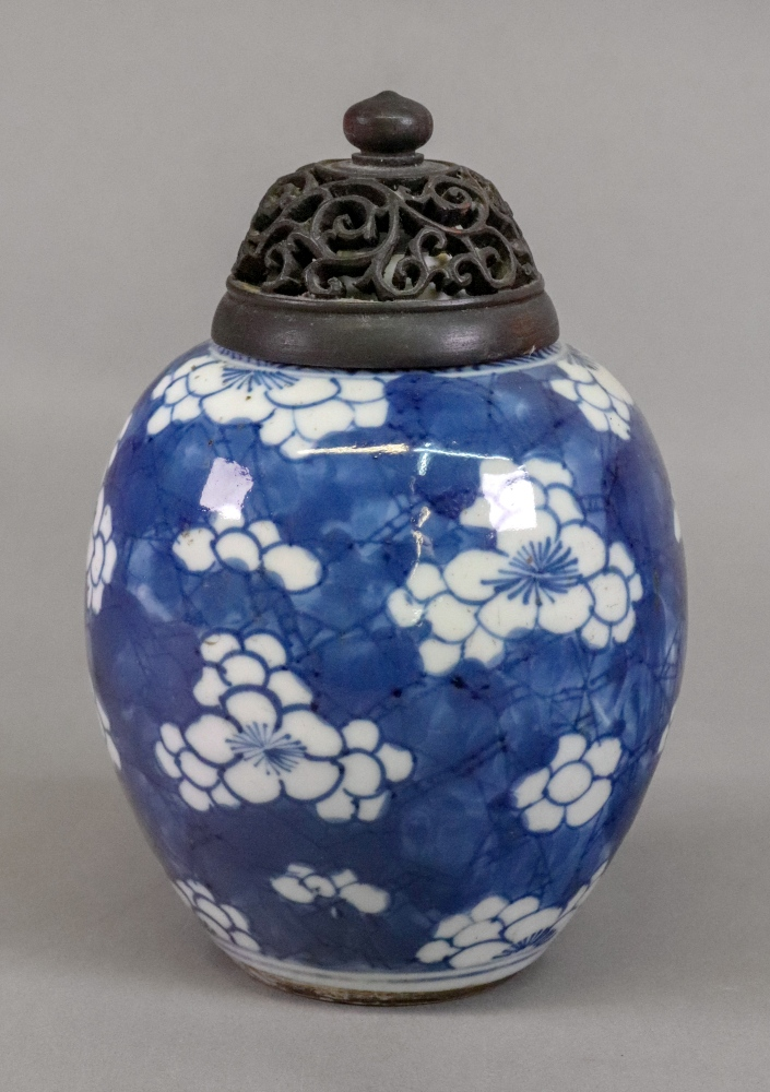 Lot 237 - A Chinese blue and white ginger jar, painted with prunus, 13cm high,