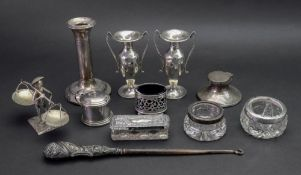 A pair of small George III style silver baluster two handled vases, Birmingham 1912,