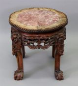 A Chinese rosewood shaped circular vase stand, Qing dynasty, late 19th century, with beaded edge,