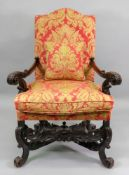 A Charles II style walnut frame armchair, with high arched upholstered back and stuff over seat,