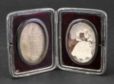 A Victorian silver double photograph frame, Andrew Barrett & Sons, London 1895,