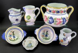 A group of Quimper Faience, 20th century, each piece painted with figures of flowers,