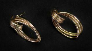 A pair of 9ct gold earrings, of openwork flattened hoop design, detailed '375' to backs, 3.