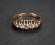 An 18ct gold and diamond-set five-stone ring, London 1906, ring size J, 2.