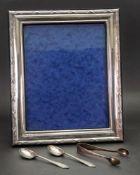A modern large rectangular silver mounted photograph frame, millennium marks,