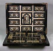 A 17th century North Italian ebony veneered and ivory table cabinet,