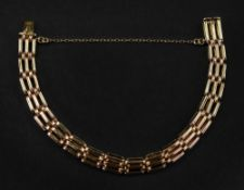 A 14ct rose gold gate-link bracelet with box and tongue clasp and trace-link safety chain, 12.