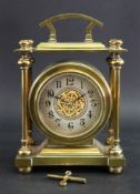 A late Victorian brass cased mantel time