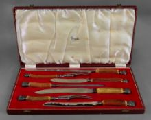 A seven piece horn handled carving knife