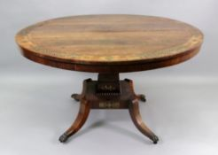 A Regency rosewood brass strung and foliate cut-brass centre table, the circular tilt-top,